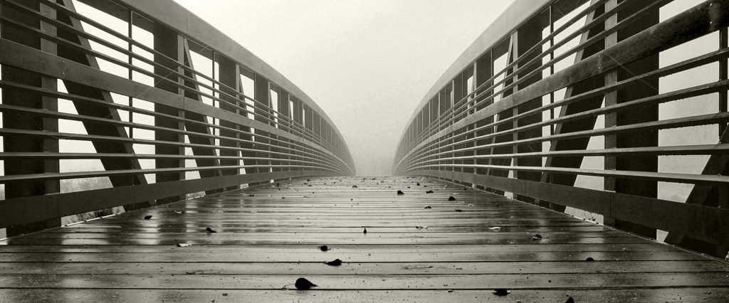artistic image: bridge and fog