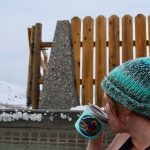 image: sipping hot drink in hot pool. winter snow